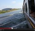 Floods in Thailand, train tries to make its way through waterjj